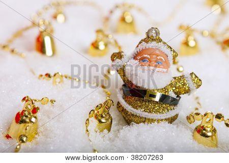 Santa Claus Figurine And Christmas Golden Bells