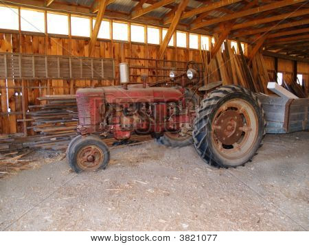 Old Tractor In A Barn