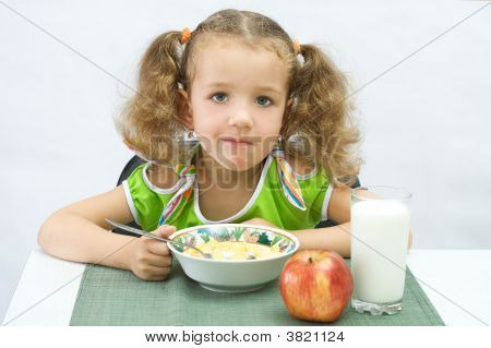 The Girl Has Breakfast Corn Flakes With Milk