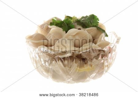 Isolated Ravioli In The Glass Plate