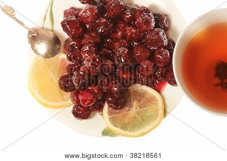 Tea With Cherry Jam And Lemon Isolated Background