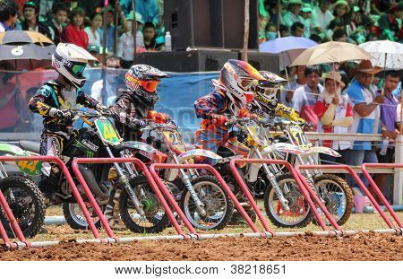 Motocross Riders Lined Up At The Start