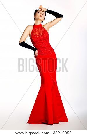 Stylish Ecstatic Young Female In Long Red Fashion Dress Posing