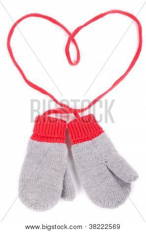 Pair Of Gray Baby Mittens On A String In The Form Of Heart
