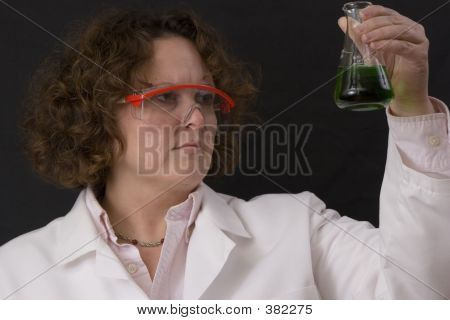 Female Chemist With A Solution