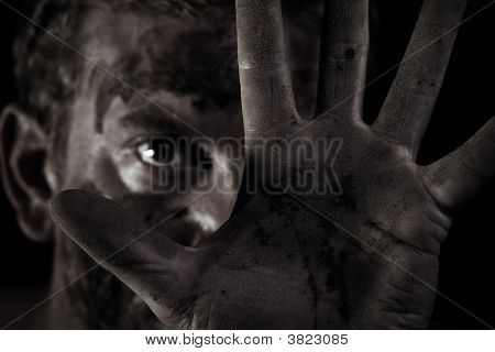 Grungy Shot Of A Dirty Male With His Hand Up