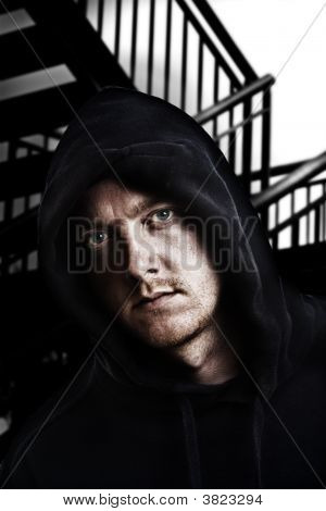 Grungy Shot Of Hooded Male In Urban Backdrop