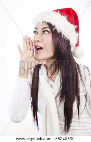 Beautiful woman with santa hat shouting