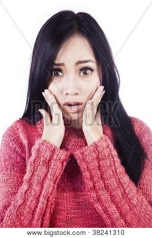 Expression Of Shock By Beautiful Asian Woman Isolated In White