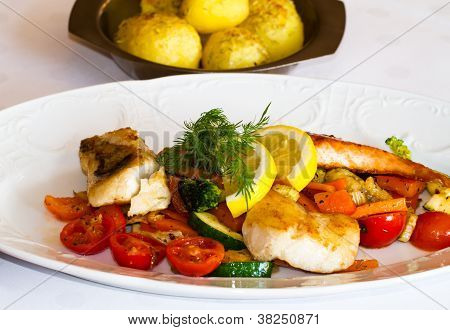 Covered table with fish dish Zander