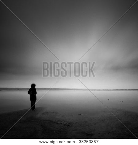 Lonely person standing near the silent lake Stock Photo & Stock ...