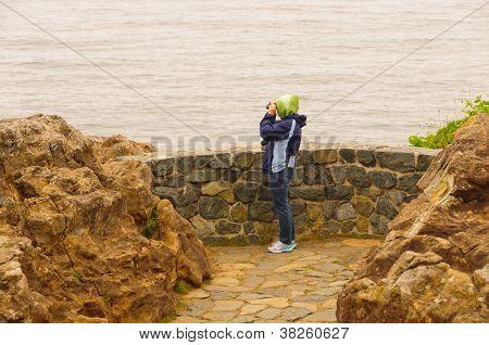 Birdwatcher On A Coastal Viewpoint