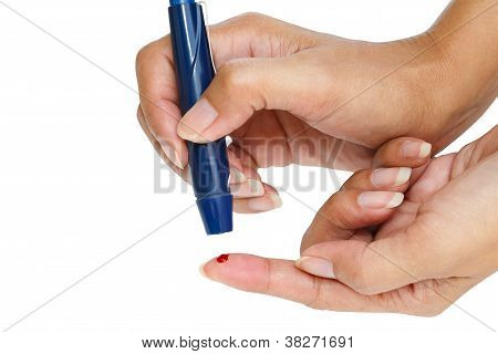 Diabetic lancet device in hand Isolated over white