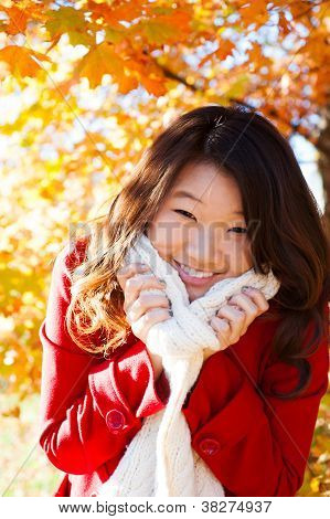 Asian Woman enjoying the fall