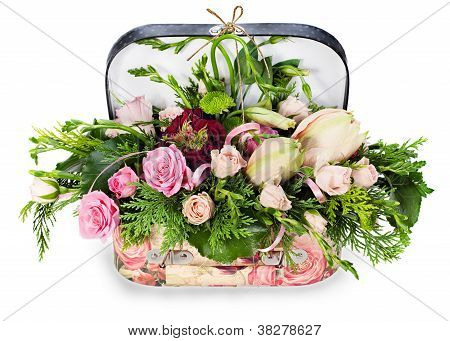 A Colorful Floral Arrangement Of Roses And Lilies In Acardboard Chest, Isolated On White Background