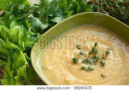 Tasty Cream Of Celeriac Soup In A Green Bowl