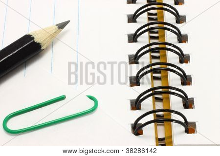 Open notepad with pencil and paper