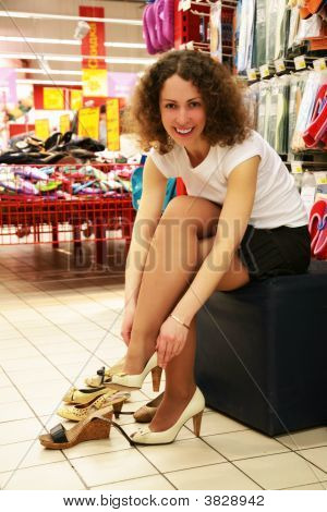 Young Woman Fitting Shoes