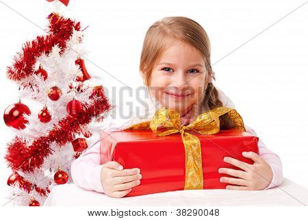 Beautiful girl embraces a gift package