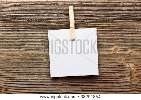 Close Up Of A Note And A Clothes Peg