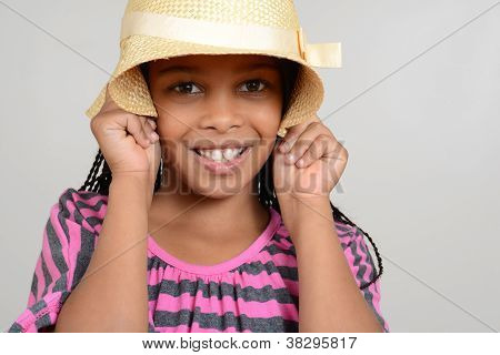 African Girl being silly with hat
