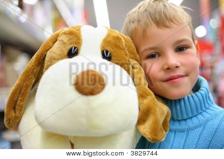 Boy With Toy Dog In Shop