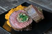 stock photo of flank steak  - Beef flank steak roulade with nuts greens and vegetable puree - JPG