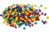 stock photo of thermoplastics  - Pile of colorful plastic polymer granules isolated on white - JPG