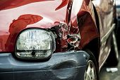 stock photo of bender  - Details of a red car in an accident - JPG