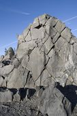 pic of mckenzie  - Fractured Rockface against a bright blue sky - JPG