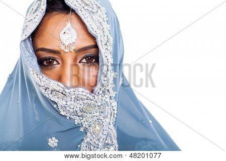 traditional Indian woman in sari covering her face with veil