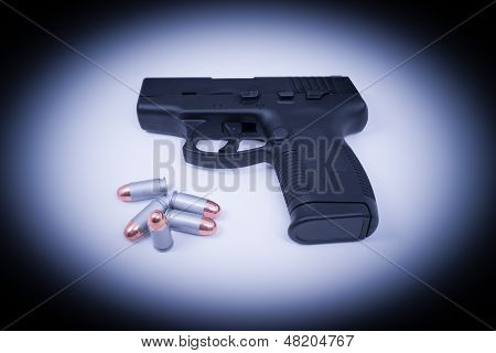 Hand Gun - Spotlighted 45 Auto and Bullets