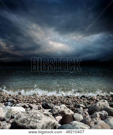 Sea Stones Waves And Dark Sky