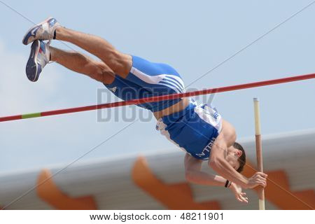 DONETSK, UKRAINE - JULY 12: Petros Hatziou of Greece competes in Pole Vault during 8th IAAF World Youth Championships in Donetsk, Ukraine on July 12, 2013
