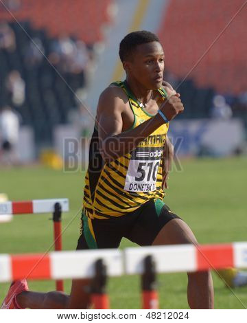 DONETSK, UKRAINE - JULY 12: Jaheel Hyde of Jamaica competes in semi-final of 110 m hurdles during 8th IAAF World Youth Championships in Donetsk, Ukraine on July 12, 2013