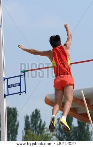 DONETSK, UKRAINE - JULY 12: Takumi Okamoto of Japan competes in Pole Vault during 8th IAAF World Youth Championships in Donetsk, Ukraine on July 12, 2013