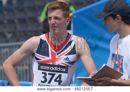 DONETSK, UKRAINE - JULY 12: Thomas Somers of Great Britain talk with press after he win the heat in 200 metres during 8th IAAF World Youth Championships in Donetsk, Ukraine on July 12, 2013