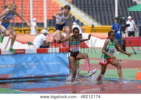 DONETSK, UKRAINE - JULY 12: Girls compete in 2000 m steeplechase during 8th IAAF World Youth Championships in Donetsk, Ukraine on July 12, 2013
