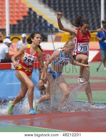 DONETSK, UKRAINE - JULY 12: Bote, Spain (left), Reina, Italy (center), Bouzayani, Tunisia compete in 2000 m steeplechase during 8th IAAF World Youth Championships in Donetsk, Ukraine on July 12, 2013