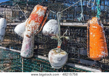 Weathered buoys and traditional lobster traps on the wharf.
