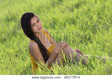 Thai Woman In The Grasses
