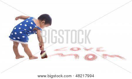 baby writing love mom on floor