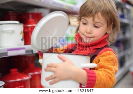 Little Girl In Shop With Pan