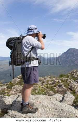 Old Man Photographer On Mountain Top