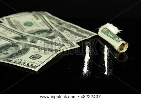 Cocaine drugs heap and lines on  mirror with rolled banknote, close up