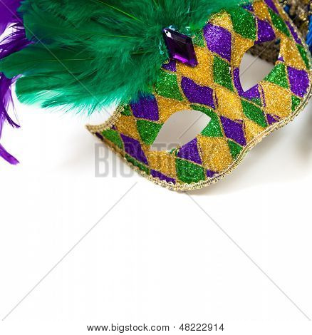 A glittery Mardi gras mask on a white background with copyspace