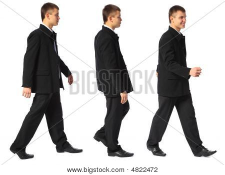 Young Smiling Businessman Walks