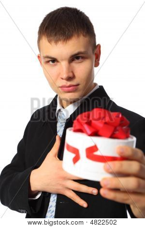 Young Businessman Gives Box With Gift