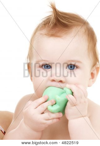 Baby Boy With Green Plastic Toy