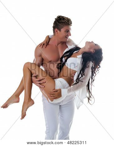 Image of muscular guy carries slim beautiful girl